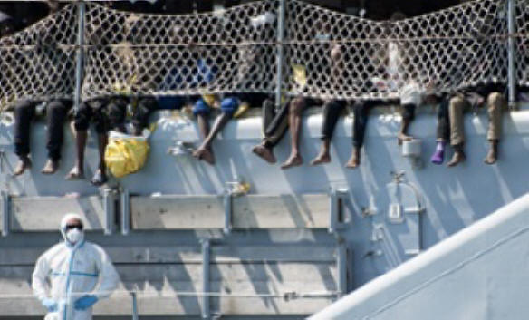 Migrants wait to disembark from an Italian navy ship in Salerno. Theresa May and Philip Hammond believe such rescue operations create a �pull factor� and lead to more deaths by encouraging migrants to risk the dangerous sea crossing.