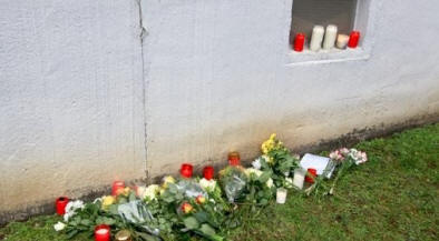 Flowers and candles at the place near his home where Khaled B. was found dead. Image/dpa.